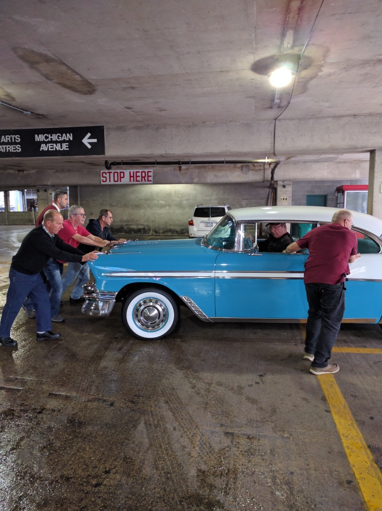 56-chevy-being-pushed-in-its-parking-spot